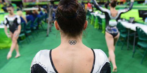 Earrings, Fashion, Back, Stadium, Ponytail, Cheerleading uniform, Chignon, Hair accessory, Bun, Cheerleading,