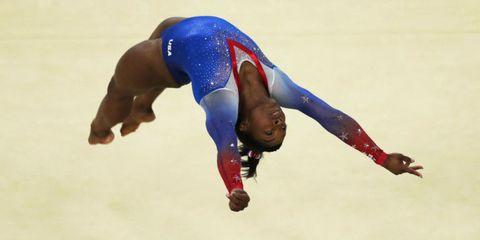 Human leg, Sportswear, Elbow, Sports uniform, Joint, Wrist, Competition event, Knee, Muscle, Artistic gymnastics,