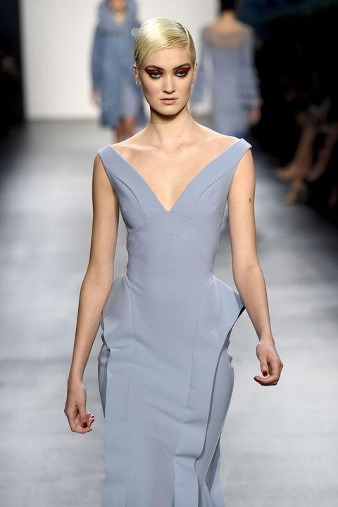 Lip, Hairstyle, Fashion show, Shoulder, Joint, Fashion model, Dress, Style, Eyelash, Runway,
