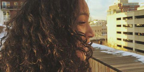 Hairstyle, Ringlet, Long hair, Black hair, Apartment, Tower block, Brown hair, Condominium, Surfer hair, Feathered hair,