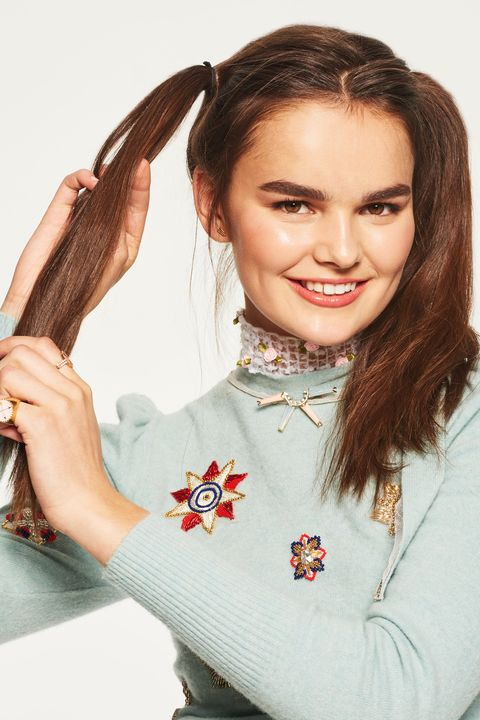 """<p>Once you've finished making your part, pull each section into a high ponytail on either side of your head. Rake a dime-sized amount of a defrizzing texturizing product&nbsp;like <a href=""""https://www.neonhair.com/collections/products/products/smoothing-sugar-cream"""" target=""""_blank"""" data-tracking-id=""""recirc-text-link"""">Paul Mitchell Neon Sugar Cream</a>&nbsp;through each ponytail. This will help keep your&nbsp;braids smooth while still giving them enough grit and hold to last through sixth period.</p>"""