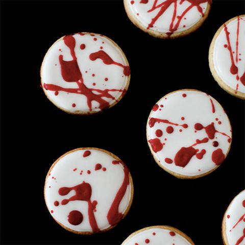 """<p>Oooh, so gruesome! Create this morbid effect by coating a basic sugar cookie with white icing, then splattering the cookies with dark red icing. </p><p><strong>Get the recipe at <a href=""""http://www.annies-eats.com/2012/10/29/blood-spatter-cookies/"""" target=""""_blank"""">Annie's Eats</a>. </strong></p>"""