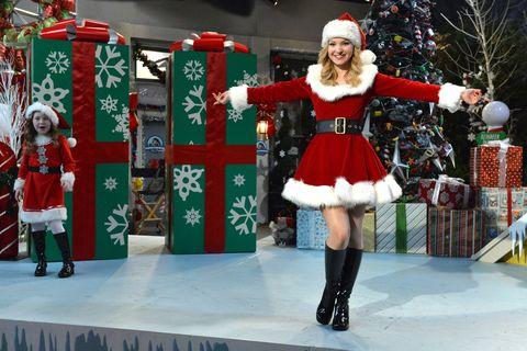 Christmas, Santa claus, Christmas eve, Holiday, Fictional character, Event, Costume, Christmas decoration, Cosplay, Thigh,