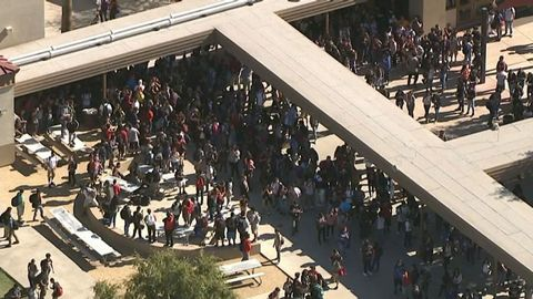 Students walk out of North High School in Phoenix, Arizona to canvas for votes on Election Day 2016