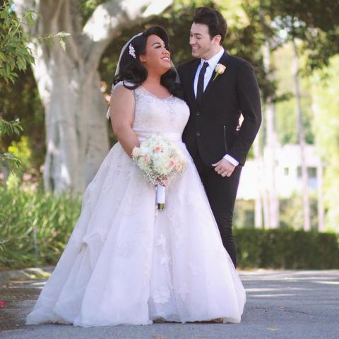 Clothing, Coat, Dress, Trousers, Bridal clothing, Photograph, Petal, Outerwear, Suit, Wedding dress,