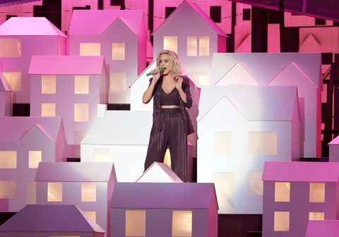 Microphone, Purple, Violet, Dress, Pink, Stage equipment, Magenta, Music artist, Music venue, Stage,