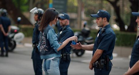 Cap, Interaction, Hat, Denim, Police, Law enforcement, Street fashion, Baseball cap, Security, Belt,