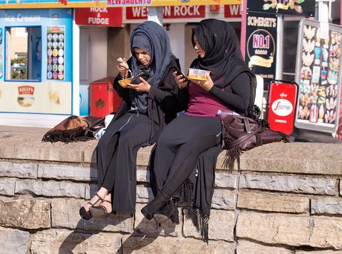 People, Snapshot, Street, Sitting, Human, Infrastructure, Leg, Photography, Road, Black hair,
