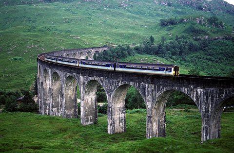 Transport, Bridge, Landscape, Arch bridge, Aqueduct, Viaduct, Rolling stock, Railway, Arch, Grassland,