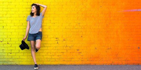 Yellow, Orange, Clothing, Wall, Blue, Street fashion, Standing, Beauty, Shoulder, Fashion,