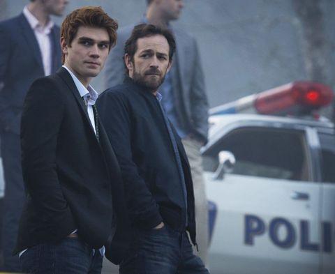 Collar, Coat, Dress shirt, Suit, Facial hair, Automotive exterior, Beard, Blazer, Police car, Police,