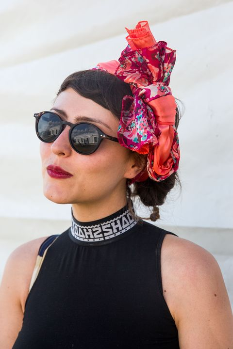 <p>Play against type and shake up a summer-goth aesthetic with a printed trophy headband. (Keep the dark lip, though.) </p>