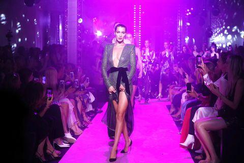 Fashion, Fashion model, Event, Runway, Fashion show, Haute couture, Magenta, Fashion design, Model, Nightclub,