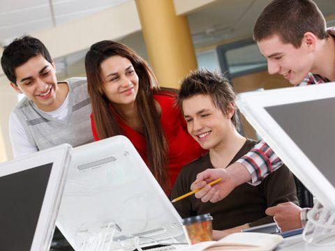 Teens Using Microsoft Office Programs at School