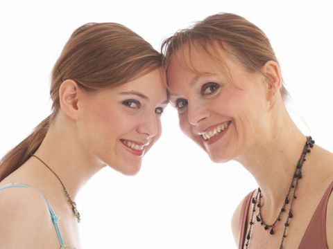 mother and daughter smiling and close together