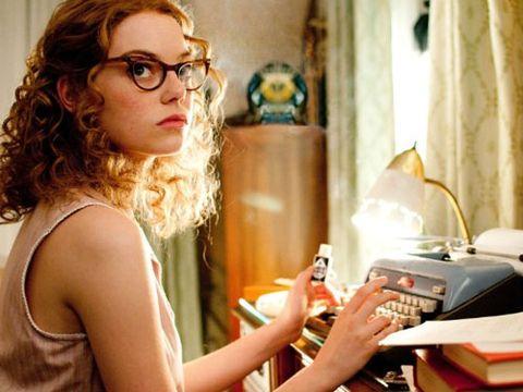 Emma Stone writing as her character Skeeter Phelan in The Help