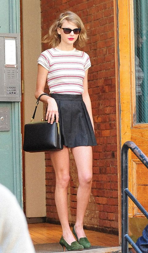 taylor swift wears a leather mini skirt and striped shirt in nyc