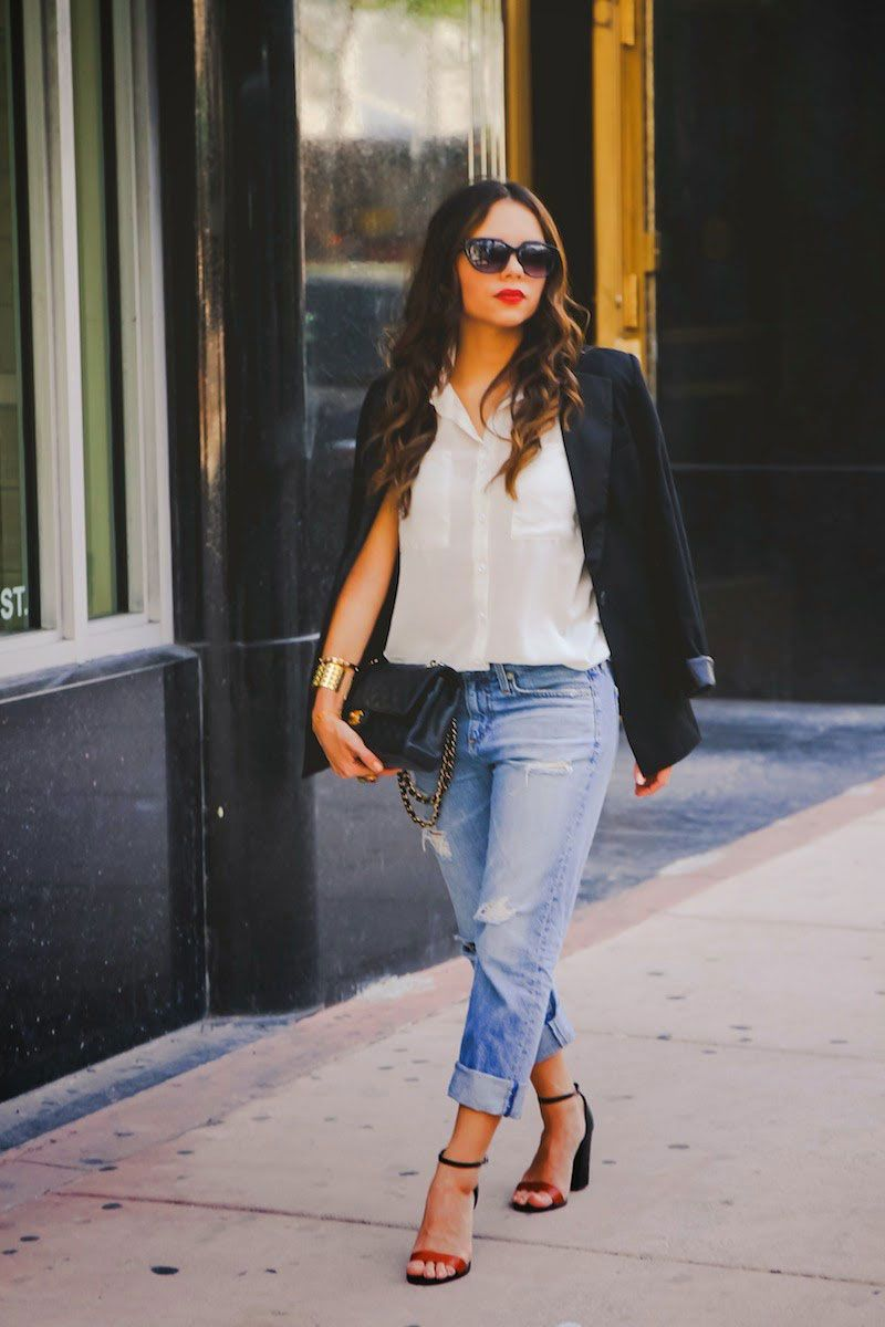 fashion blogger nanys klozet pairs distressed boyfriend jeans with a blazer for polished #ootd inspo