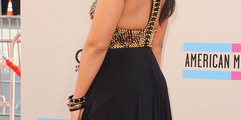 Shoulder, Dress, Flooring, Fashion accessory, Premiere, Eyelash, Style, Formal wear, Logo, Fashion,