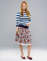 girl in a striped shirt and print skirt