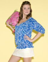 model in tropical preppy clothes