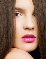 model wearing bright pink lipstick
