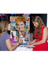 Katherine Schwarzenegger signing an autograph at Atlantis event