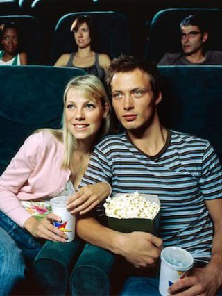 boy and girl in movie theater