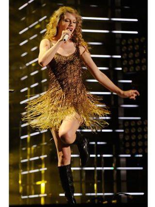 taylor swift on stage performing