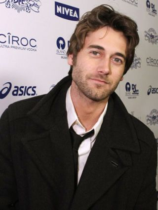 ryan eggold in black coat shirt and tie