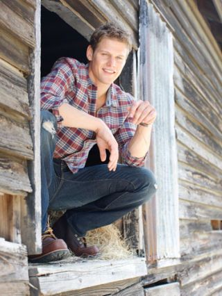 zach roerig crouching in barn window