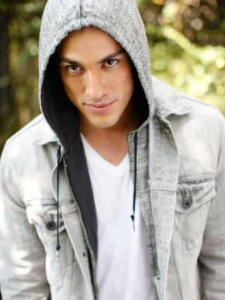 michael trevino in gray hoodie