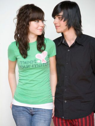 girl in green tshirt flirting with boy in black buttondown