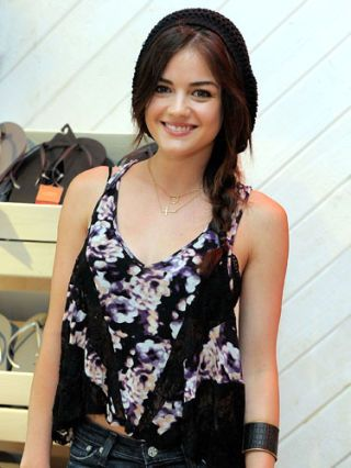 lucy hale at a pop up shop for Havaianas Mercado