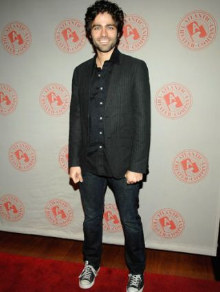 adrian grenier in dark suit jacket and jeans