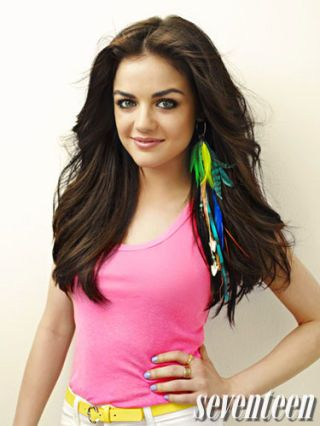 lucy hale in a pink tank top and colorful feather earrings shot for seventeen magazine