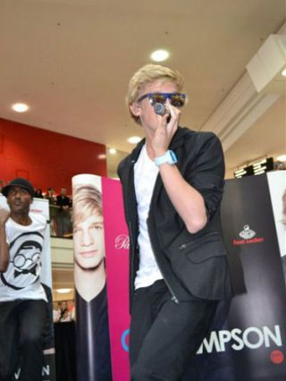 Cody Simpson performing live in a mall for fans