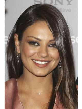 Mila Kunis at friends with benefits movie event