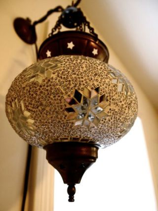 Interior design, Christmas decoration, Christmas ornament, Holiday ornament, Ornament, Metal, Sphere, Light fixture, Circle, Natural material,