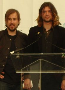 members of taking back sunday at a podium