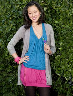 model in bright ensemble with gray sweatshirt