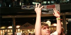 jesse mccartney on stage with hands in the air