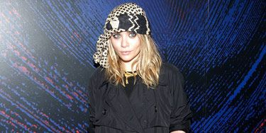 ashley olsen in black trench coat and head scarf