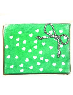 green and white heart gift wrap with bow