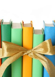 picture of a stack of books with a bow