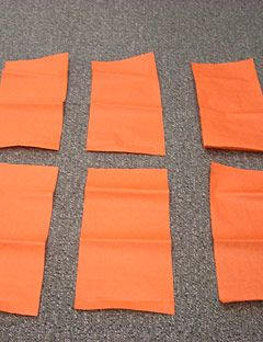 strips of orange tissue paper