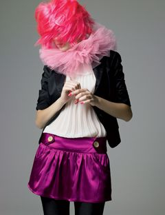 girl in hot pink wig and a purple skirt