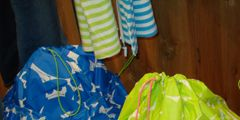 blue and green draw string beach bags