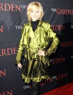 girl wearing a metallic green robe