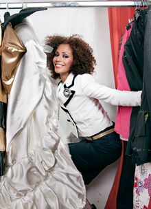 girl in a closet full of clothes